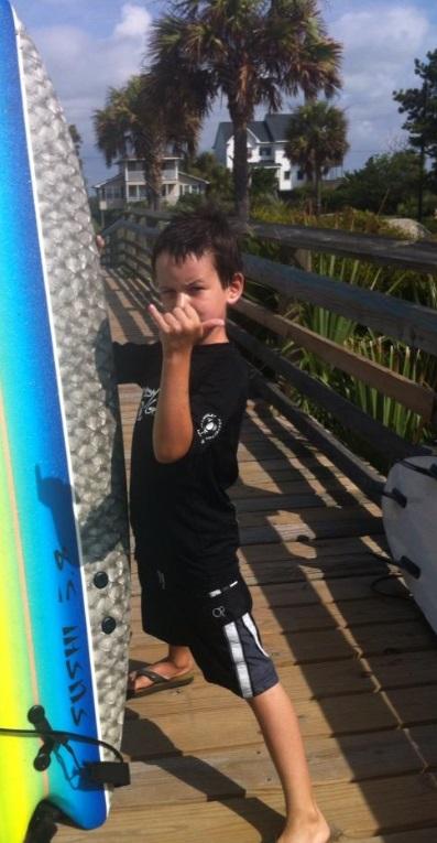 beach bumf family surfing boy